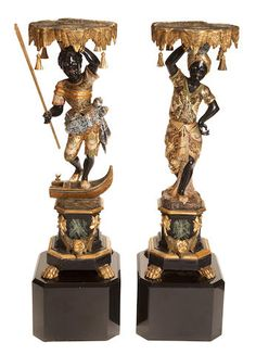 A pair of Venetian parcel gilt, polychrome and ebonized figural torchères together with later black marble plinthsthird quarter 19th century