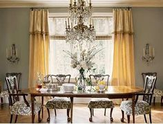 This dining room has a lot of traditional elements, but the sisal rug and slipcovers on the seat of the chairs freshen up the space. Description from thingsthatinspire.net. I searched for this on bing.com/images