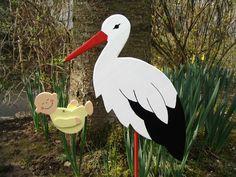 Storch aus Holz mit Baby (gelb) - 60cm hoch