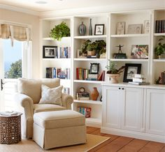 large bookshelf and display cabinet in living room wth neautral decor