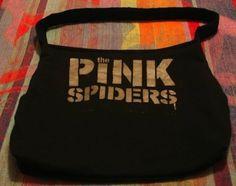 Make a too-big band shirt into a purse.   14 Cute DIYs To Make An Old Band T-Shirt Cool Again