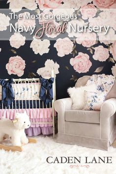 I'm in love with this navy and pink peony wall! Love this nursery for a baby girl