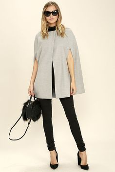 Even Sherlock Holmes would be jealous of the BB Dakota Cambridge Heather Grey Cape! Felted, heather grey fabric forms a collarless neckline (with two hidden snap closures) and a sloping silhouette with cape arm openings at front.