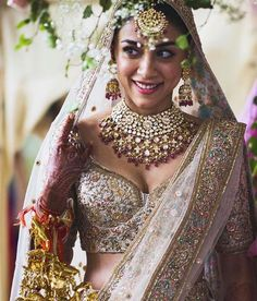 Popular actress Amrit Puri too paired her ivory lehenga with a heavy bridal necklace done with polkis and lilac tourmalines for her Anand Karaj. Indian Bridal Outfits, Indian Bridal Wear, Bridal Dresses, Indian Dresses, Bridal Looks, Bridal Style, Sabyasachi Bridal Collection, Lehenga Collection, Sabyasachi Lehenga Bridal