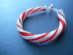 This Candy Cane Herringbone Bangle is absolutely adorable for Christmastime.