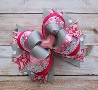 "This listing is for a simply sweet hair bow. The bow is layered in multiple shades of pink, grey and printed ribbon. The bow is finished with a sweet heart pink resin centerpiece. This bow measures about 5"" and can be mounted on an alligator clip or a french barrette. All ribbon ends are heat sea..."