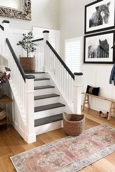 Ready to amp up the drama in your entryway? Here are eight black and white staircase ideas to see how the high-contrast look can work for you. #hunkerhome #blackandwhitestaircase #staircaseideas #staircases #staircasesinspo #blackandwhitestairs