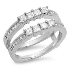 An elegant, vintage-inspired way to showcase her diamond solitaire, this exquisite wrap is a sparkling delight. Fashioned in 10K White Gold, this unique double design features trios of shimmering diamonds that create 'tiaras' around her solitaire. The double shank sparkles with additional diamonds. Radiant with 1 ct. of diamonds, this ring guard is finished with a bright polished shine.