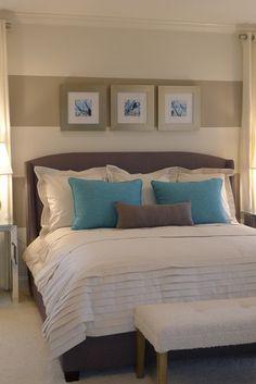 Neutral, dark bed, white bedding, blue accents, striped walls. Love!