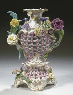 SECOND HALF 19TH CENTURY<br>Applied with pink flowerheads and naturalistic flowers (minor chips)<br>31 cm. high
