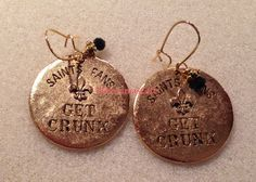Ladies it's that time of year....time to get ready for some SAINTS FOOTBALL!!!!! Let's GET Crunk!!!! Show your NOLA pride.<br><br>Item Description:<br>1 Custom Made Pair of Earrings<br>Black  Beveled Beads<br>Gold Accent Bead Beads<br>Saints Fans Get Crunk, Fleur de Lis Charms<br><br><br>Payment:<br>I accept an...