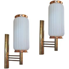 Italian White Glass and Brass Sconces | From a unique collection of antique and modern wall lights and sconces at https://www.1stdibs.com/furniture/lighting/sconces-wall-lights/
