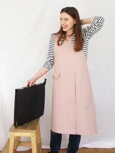 Beautiful, but utterly functional potters apron. Designed for the needs of artists & makers, the overlapped split skirt gives lots of movement, whilst ensuring each leg is perfectly covered when sitting at the wheel or work bench. Comfortable design, with cross back straps, easy-fit, with no ties around the neck - 2 roomy pockets, loop for cleaning cloth etc. 'Tn The Making - Aprons' artisan handmade Split Legs, Split Skirt, Back Strap, Petite Size, Aprons, Pale Pink, Cotton Canvas, Work Wear, Ties