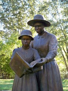 """""""Woman and Child Reading statue at the Corinth Contraband Camp"""" - Union-occupied Corinth, Mississippi, became a temporary home for thousands of newly freed African-Americans. This thriving community had their own church, school, hospital, and farm. In less than a year, over 1,000 ex-slaves, both children and adults, learned to read."""