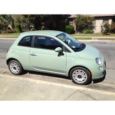 Green fiat 500, I think. It is just so cute.