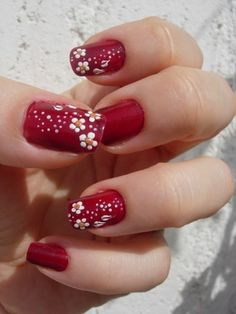 Cute white flowers on red nails