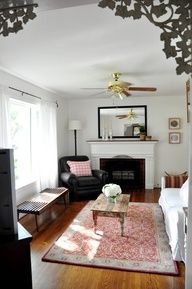 Small, Narrow Living Room Arrangement With Fireplace Opposite The Corner  TV, And Couch Facing