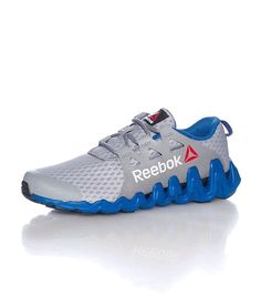 b3431b4bcff REEBOK Low top men s sneaker Lace up closure Mesh for ventilation REEBOK  logo on sides Cushioned inner sole Classic zig outsole