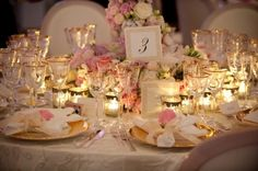 Antique gold trim and pink florals provide a wonderful vintage-inspired wedding table