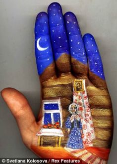 Striking: Artist Svetlana Kolosova has been creating stunning works of art on the palm of her hand for the past five years