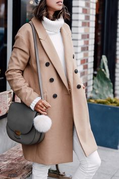 Annabelle from Viva Luxury Blog tops her all white monochromatic look with our camel double-breasted coat for a chic and sporty street style outfit | Banana Republic