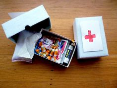 Flu & Cold survival kit made out of an old check box covered in felt and filled with emergen-c, cough drops, advil, handwipes, tissues, etc. Cute idea for a gift.