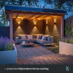 Eén zithoek is in deze tuin overdekt met een houten, verlichte terrasoverkapping 💡. Deze hebben we bevestigd aan de schutting. Hier kan je heerlijk beschut zitten, een boekje lezen of een maaltijd nuttigen. De andere hoekjes zien? Bezoek onze website. #zithoek #tuin #terras #overkapping #tuininspiratie Backyard Gazebo, Backyard Seating, Outdoor Pergola, Garden Seating, Backyard Landscaping, Outdoor Patios, Landscaping Ideas, Outdoor Living, Outdoor Garden Rooms