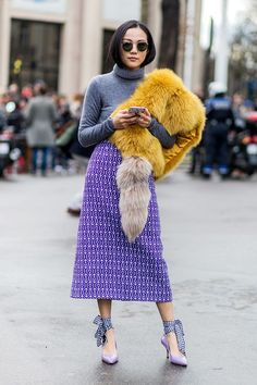Lightweight sweaters are the ultimate layering pieces. Here's how fashion girls are styling theirs.
