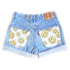 "Reworked Levi's light/medium wash high waisted shorts with authentic 90's smiley face fabric sewn on both back pockets. So perfect for raves and festivals. At checkout, please let us know: - cuffed or frayed hem - inseam preference By default, your shorts will have a frayed hem and 2"" ins..."