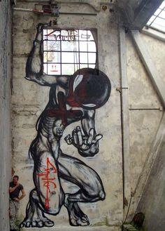 Atlante-graffito al Proprietà Pirata Riot Club #streetart #graffiti #gattonero #milano