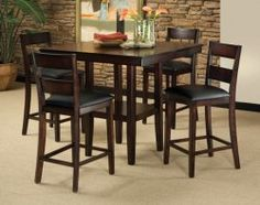 Dine in style with the contemporary Pendleton pub table set. This sturdy collection is made from high-quality woods and mango veneers, so it's built to last no matter how hectic dinner with the family may be. Finished in a dark cherry with dark brown edge burnishing, this table pairs beautifully with the clean lines and black cushioned slip seats of the slat backed chairs. It's simplicity makes a bold statement in any dining room. ($398)