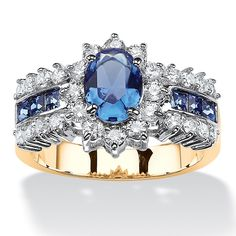 A lovely oval blue crystal is the star of this Simulated Sapphire and Cubic Zirconia Halo Ladies' Ring from Palm Beach Jewelry. Blue crystal baguettes flank the bold center stone, with a halo of radiant cubic zirconia playing a beautiful supporting role. Rose Gold Promise Ring, Palm Beach Jewelry, Halo Rings, Women's Rings, Diamond Rings, Blue Rings, Signet Ring, Blue Crystals, Blue Sapphire