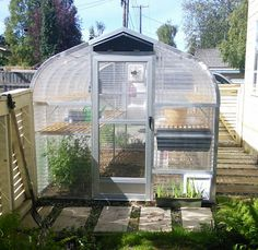 8x15 Sunglo greenhouse. This customer used one side of her greenhouse as a fence! Pretty cool! Greenhouse packages include cedar shelving, soil tray, heating and ventilation with controls and more! www.facebook.com.sunglo.greenhouse