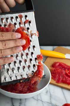 Grating vegetables is nothing new — we grate carrots and cabbage for slaws, zucchini for muffins — yet you're wondering, why would I ever grate a tomato? The simple answer is that grating a tomato is the fastest and easiest way to peel and purée a tomato in one fell swoop, but there are a few more reasons too.