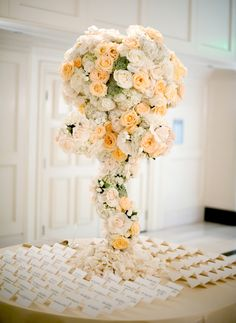 Table centerpieces | All white wedding ceremony with flowers in whites and nude colors, using Sahara roses, white ranunculus, white roses and white hydrangea | Yvette Roman Photography | Boutique Events LA | Tic Tock Couture Florals