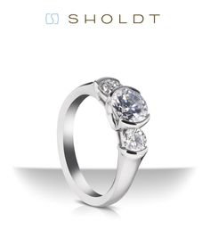 A contemporary twist on the three stone style by Sholdt #engagement #ring #threestone #JohannesHunter