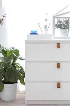 DIYs That Start With a Trip to Ikea: It's hard to believe that this dresser is from Ikea. Following this leather pull tutorial, strips of leather can become a stylish upgrade for only $10!  Source: Sugar and Cloth