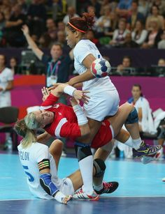 Heidi Loke of Norway clashes with Camille Ayglon and Alexandra Lacrabere of France in the Women's Handball preliminaries Group B - Match 6 between Norway and France on Day 1 of the London 2012 Olympic Games at the Copper Box on July 28, 2012 in London, England.