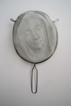 Strainer sculpture byIsaac Cordal