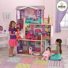 My girls have really been into their dolls lately, so they will be over-the-moon for this KidKraft Elegant Doll Manor. If you're wanting a dollhouse for smaller sized dolls, such as Barbie. KidKraft has plenty of those to choose from too. Gifts for Girls Wooden Dollhouse, Dollhouse Dolls, Dollhouse Ideas, Ag Dolls, Girl Dolls, Four Rooms, Our Generation Dolls, Doll Furniture, Dollhouse Furniture