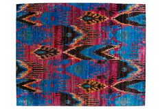 Digging the colors of this silk ikat rug.
