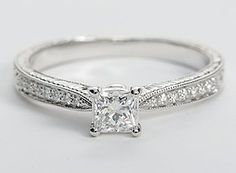 Inspired by vintage design, this diamond engagement ring in 14k white gold features milgrained edges that frame a hand engraved motif set with petite round diamonds to frame your center diamond. (Hand Engraved Micropave Diamond Engagement Ring)