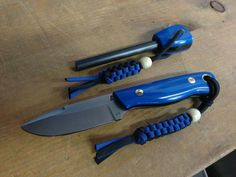 Custom Blind Horse Knives Brumby. Prototype. Matching fire steel and paracord lanyards. Beautiful blue knife.