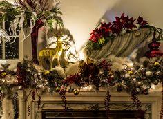 Mantle Christmas.  Gold deer.    Vintage A.M. & A's sled.   Buffalo Christmas House Tour 2016