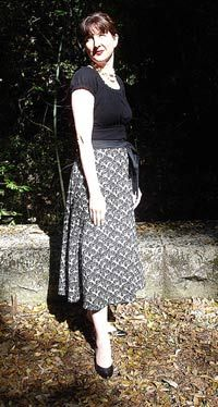 I already have a huge box of beautiful coordinating fabric (some from House of 66 Cents in Okinawa!) to make a bunch of these wonderful reversible wrap skirts for myself!  There's no hemming!  And it's reversible!  And it can shrink with my post-partum belly!  Who could ask for more from a skirt?