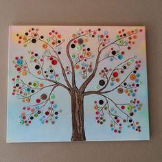 Schilderij van een boom gemaakt met gekleurde knopen