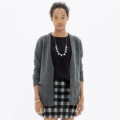A boxy-cool cardigan with a cozy bit of slouch. Easy, minimalist—anything but square.<ul><li>True to size.</li><li>Merino wool.</li><li>Dry clean.</li><li>Import.</li></ul>