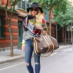 The two items in every girl's closet? Ripped jeans and a striped sweater. You know you can work these pieces into any ensemble, so you might as well wear them while you're traveling. A blanket scarf works just as well as your go-to jacket while you're in transit.