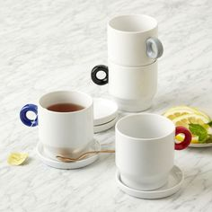 Universal Expert Stacking Mug Set | West Elm $60 4 mugs with lids that double as coasters (8 pieces total)