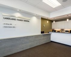 Lakeland Family Dental.  A simple, modern reception area is business efficient, yet the warm materials and finishes are inviting to patients.
